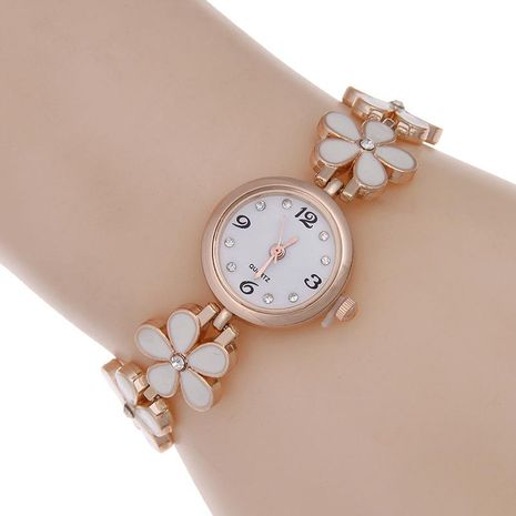 Korean version of the ladies rhinestone bracelet four-leaf clover table NHSY133220's discount tags