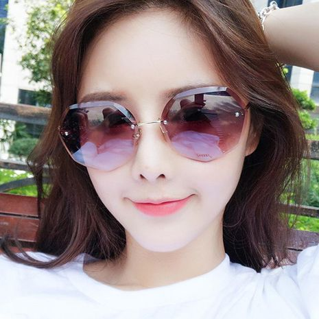 Fashion frameless polygon female big box round face sunglasses NHKD133268's discount tags