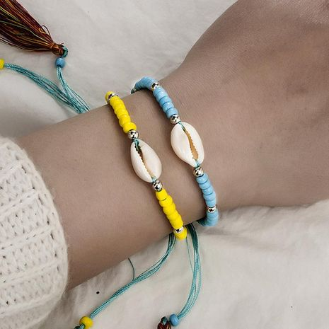 Fashion woven string rice beads shell color tassel bracelet NHGY134340's discount tags