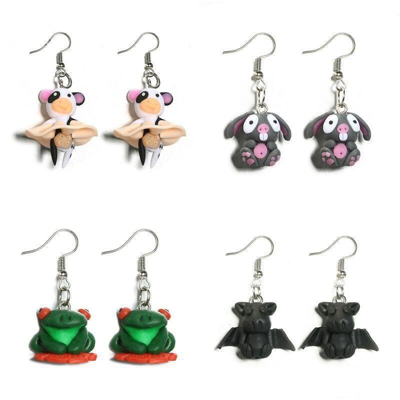 Cartoon cute handmade clay animal small flying pig bat pig earrings NHGY130638