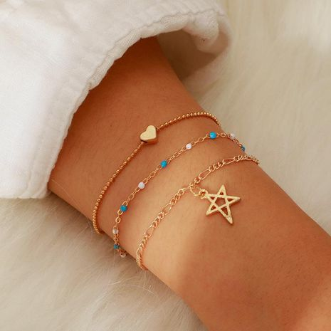Creative simple alloy hollow star rice beads chain 3 layer bracelet NHGY138181's discount tags
