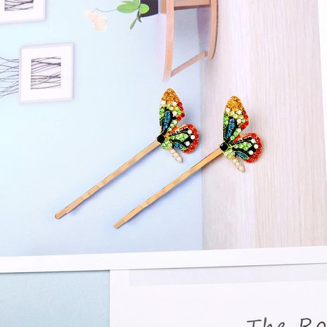 Butterfly-studded hair clip NHQD131160's discount tags