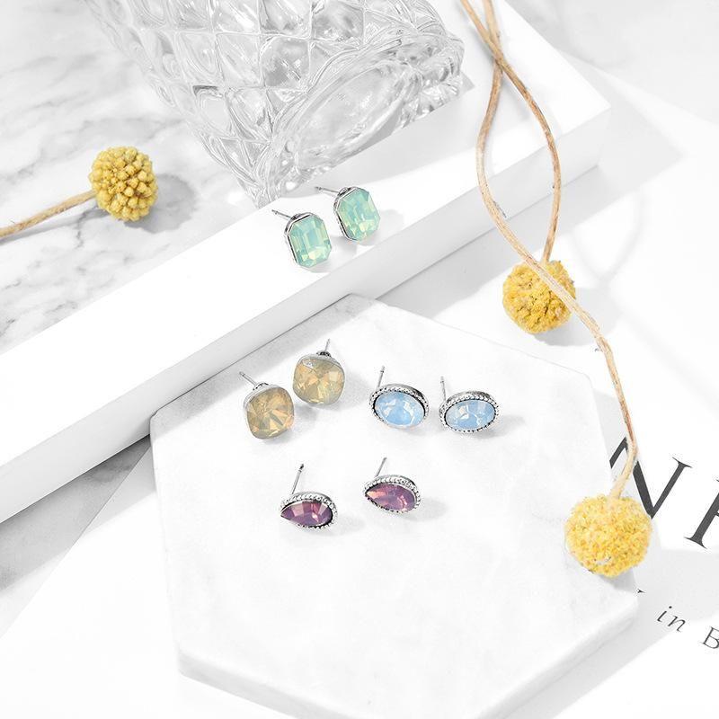 Fashion color resin creative teardrop type alloy earrings set NHXS132523