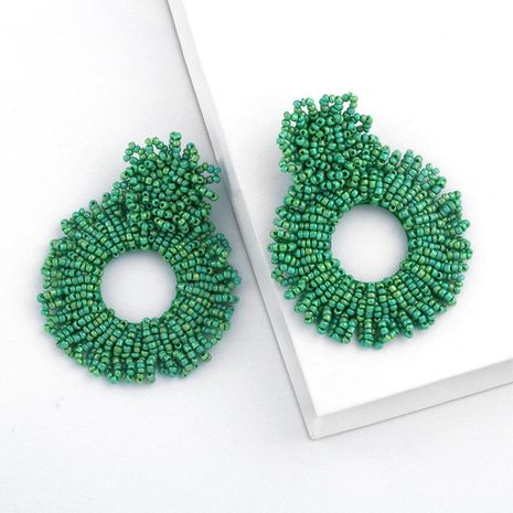 Creative woven round openwork woven rice earrings NHAS132623's discount tags