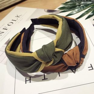 Korean version of the simple solid color fabric hit color middle knot knotted wide side headband NHSM143905's discount tags