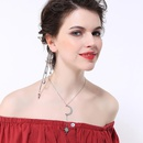 Long exaggerated stars and moonstudded earrings NHQD143867