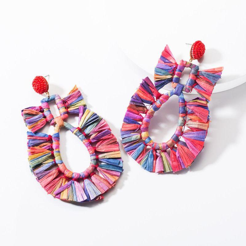 Fashion drop-shaped hollow raffia earrings NHJE144654