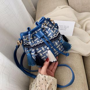 Fashion casual tassel slung bucket bag NHTC146287's discount tags