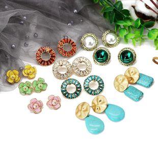 Fashion flower round colored rhinestone earrings NHOM148014's discount tags