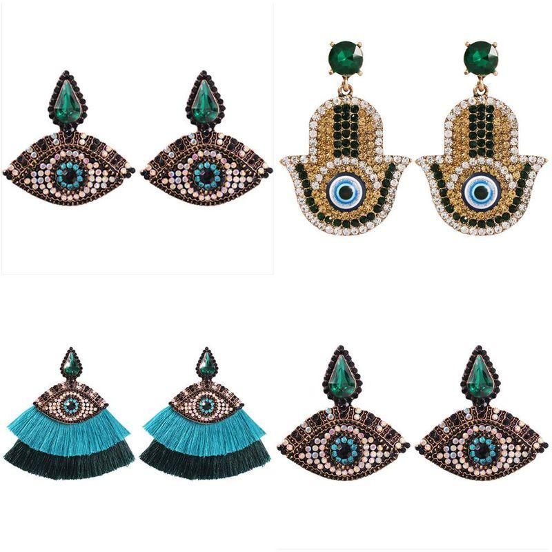 Vintage wind-studded tassel earrings NHMD139881