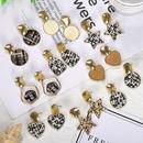 Creative fashion matte woven metal sheet stud earrings NHJQ139874