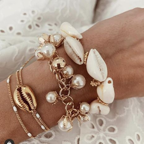 Bohemian exaggerated alloy pearl tassel chain bracelet NHGY152591's discount tags