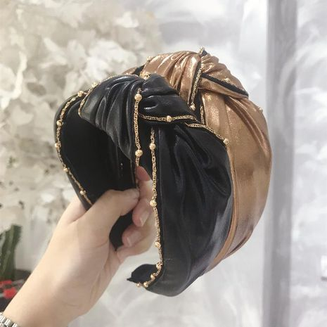 Korean version of imitation leather PU fabric bead knot knotted wide-brimmed headband NHSM153481's discount tags