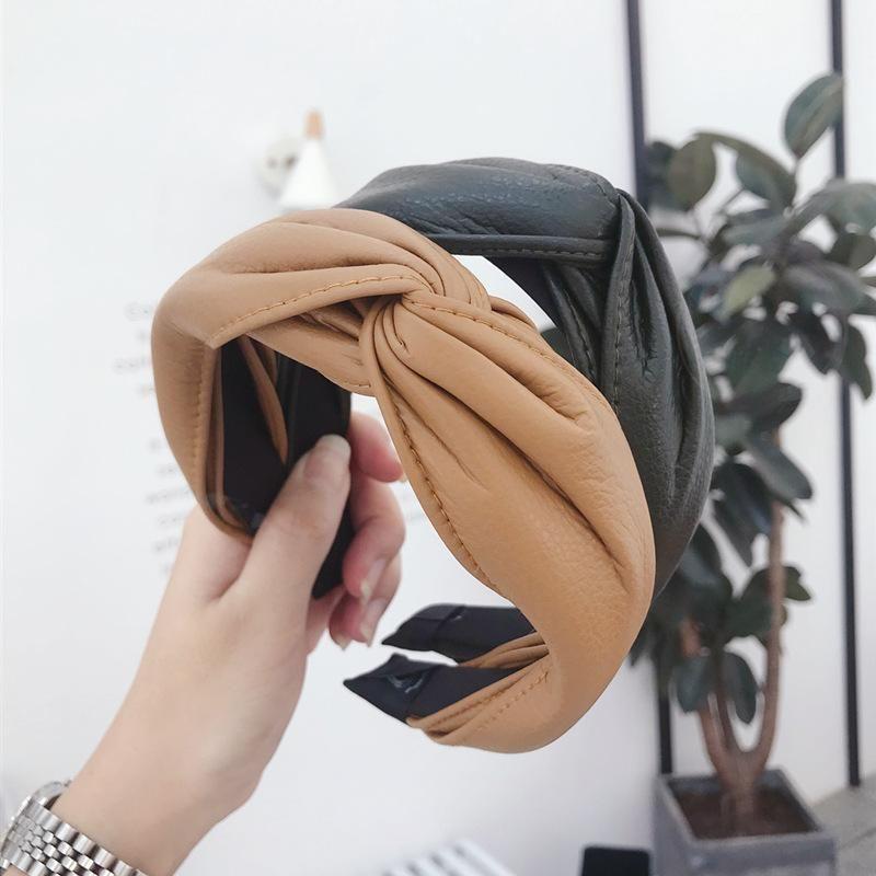 Korean version of autumn and winter PU imitation leather cross hook hook wide side headband NHSM153514
