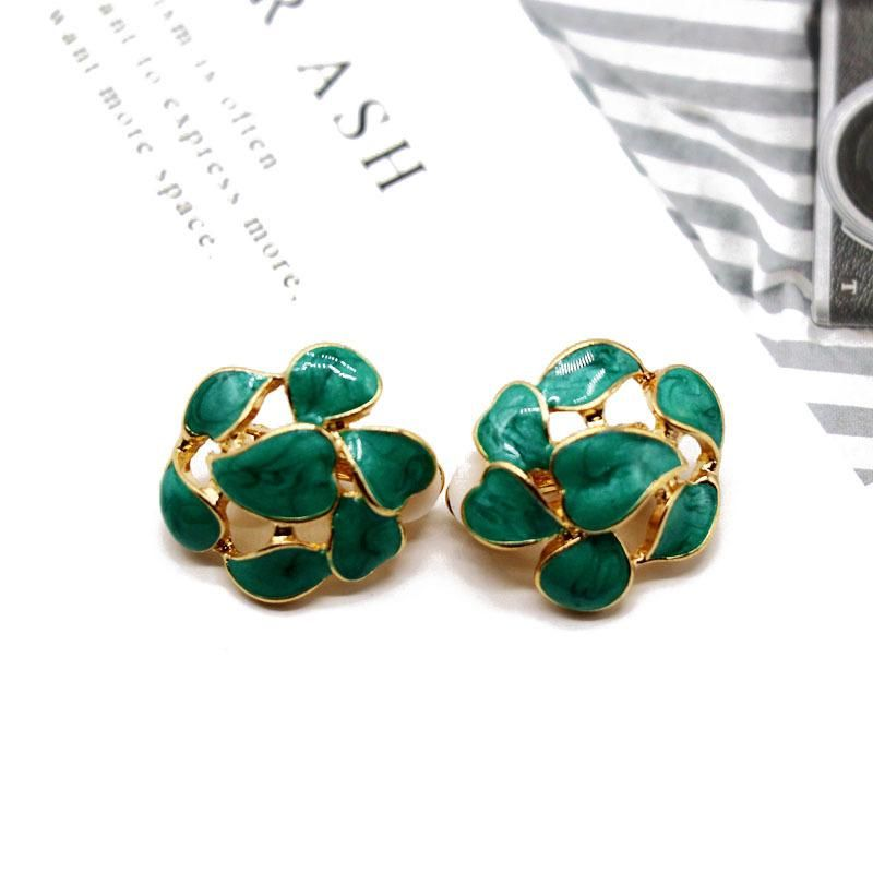 Green leaves hollow round 925 silver needle alloy earrings NHOM155033