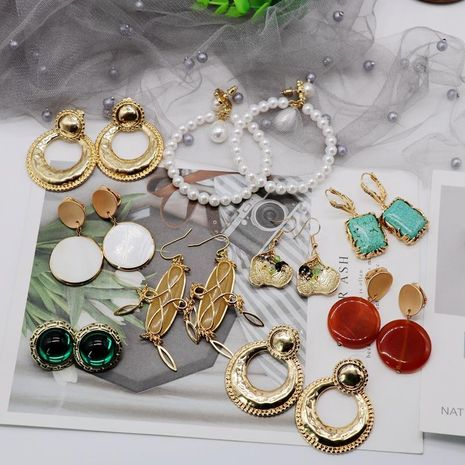 A variety of fairy pearl stone alloy earrings NHOM155158's discount tags