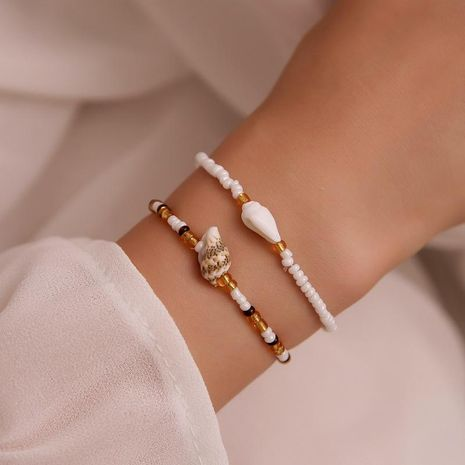 Hand-woven string millet beads shell conch color bracelet NHDP155489's discount tags