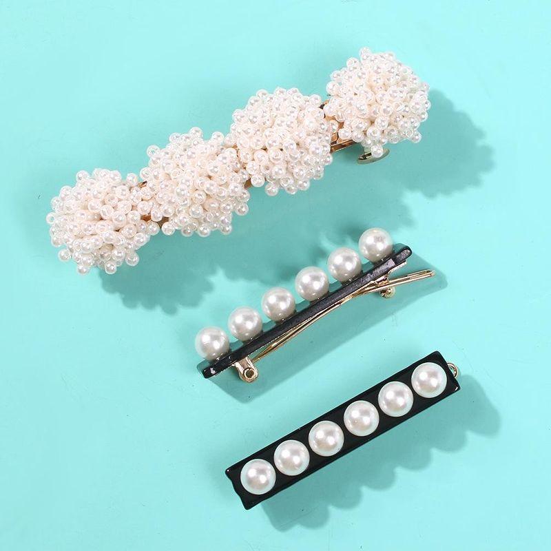 Simple wild pearl flower resin hair accessory NHMD150356