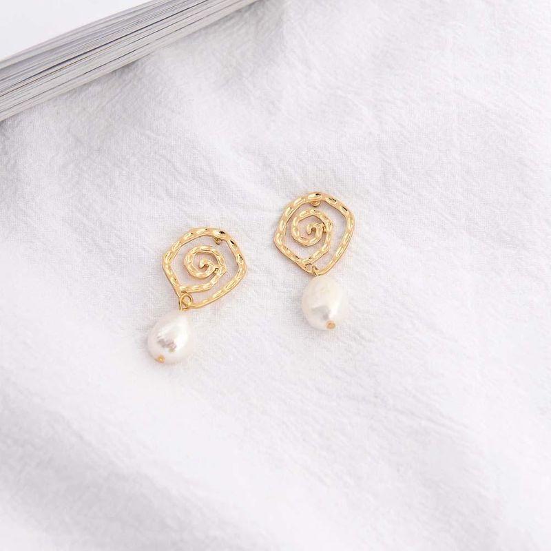 Korean fashion simple pearl earrings retro handmade alloy shell earrings geometric irregular earrings NHQS194700