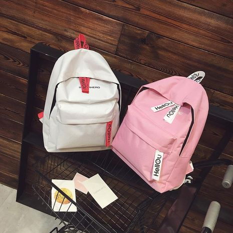 New solid color canvas soft girl girl pink backpack campus Hello travel backpack NHXC192206's discount tags