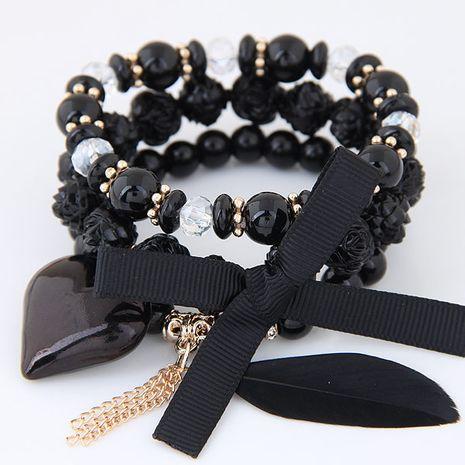 Bracelet multicouche de tempérament de perle de bonbon sauvage de coeur de pêche d'arc de mode NHSC192399's discount tags