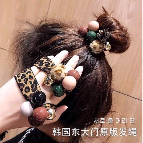 Hair rope leopard hair ring adult headdress bracelet dual-use simple tie hair pearl head rope rubber band female Korean NHSC192393's discount tags