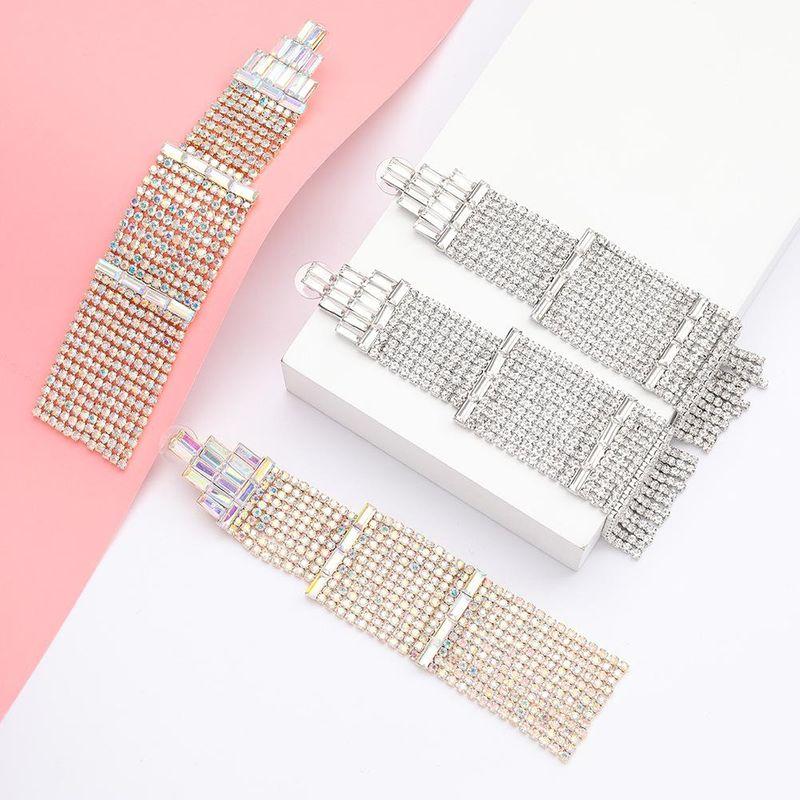 Women's multi-layer rhinestone and diamond pagoda-shaped geometric earrings NHJE192773