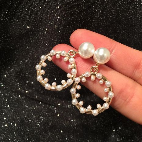 Aretes circulares de metal con diseño creativo de perlas pendientes geométricos NHWK193417's discount tags