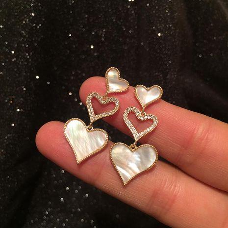 Micro incrustaciones de circón con forma de corazón hueco aretes largos con flecos NHWK193425's discount tags