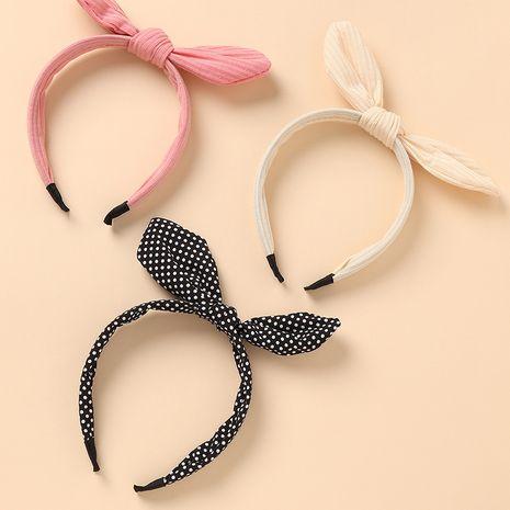 Korean fashion new girls wild simple sweet bow tie red headband NHAU267349's discount tags