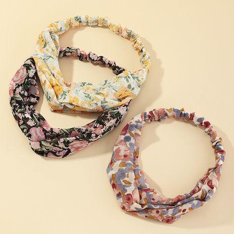 Korean fashion flower fabric printing headband cross-knotted face wash headband NHAU267354's discount tags