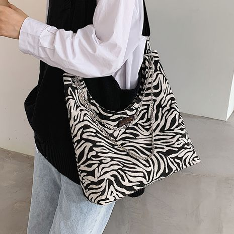 Zebra pattern cloth large-capacity shoulder wideband messenger new fashion trendy chain bag NHLH267486's discount tags