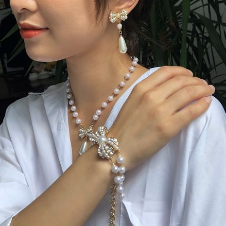hot-selling  palace luxury pearl diamond earrings bracelet necklace set wholesale NHMD267868's discount tags