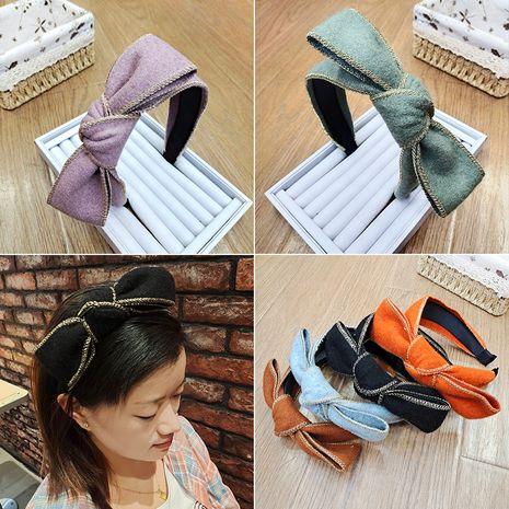 Korean  bow retro woolen cloth headband NHUX267877's discount tags