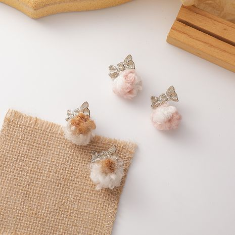 New soft lamb hair ball bow autumn and winter earrings NHMS268609's discount tags