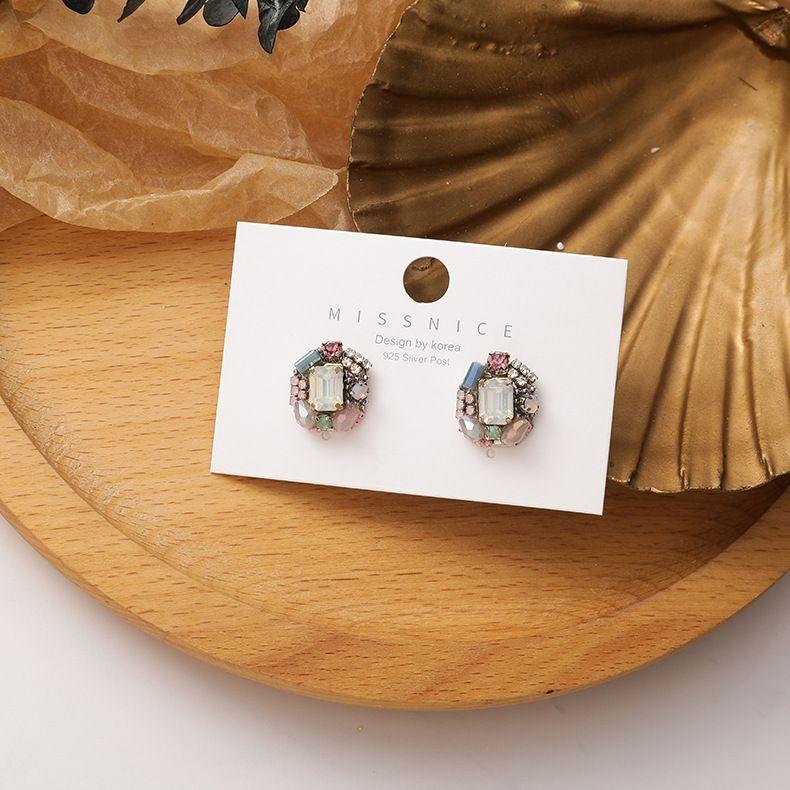 925 silver needle trendy Korean colorful crystal gem oval earrings  NHMS268650