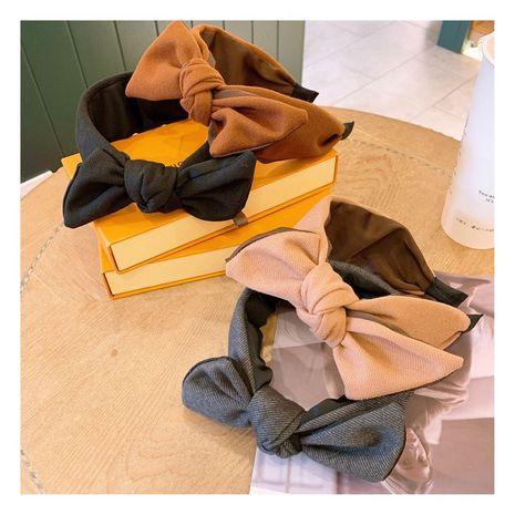 Korean  retro woolen plain fabric big bow headband  NHHD268681's discount tags
