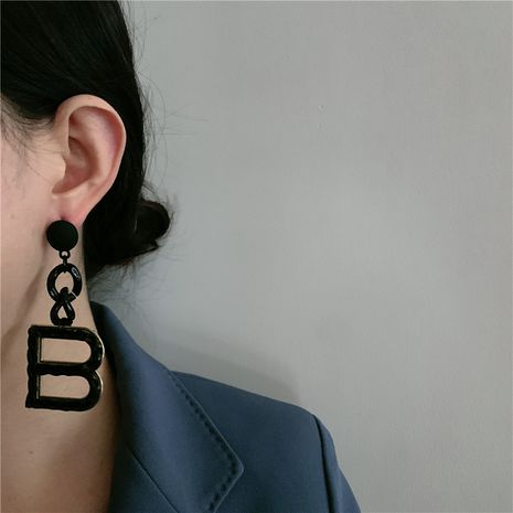 Korean new handmade leather matte black tassel pendant big B long earrings  NHYQ269405's discount tags