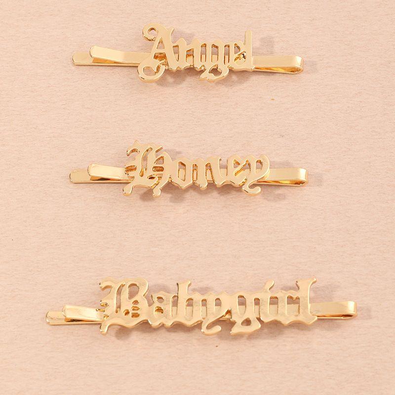 Korean retro English alphabet hair clip wholesale NHAU269425