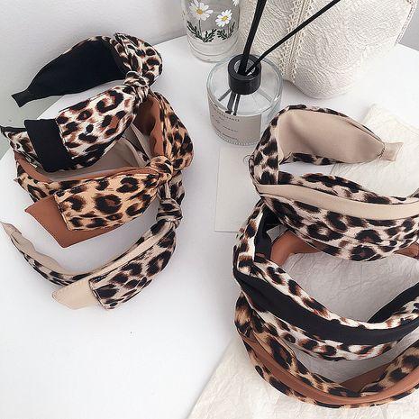 Korean new autumn and winter leopard print bow cross hair band  NHHI269622's discount tags