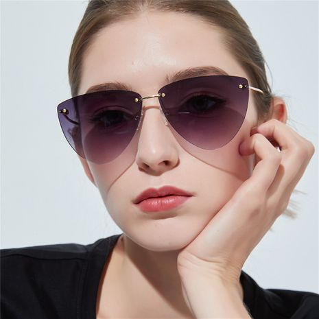 pink frameless elegant colorful lens cat eye sunglasses NHXU269897's discount tags