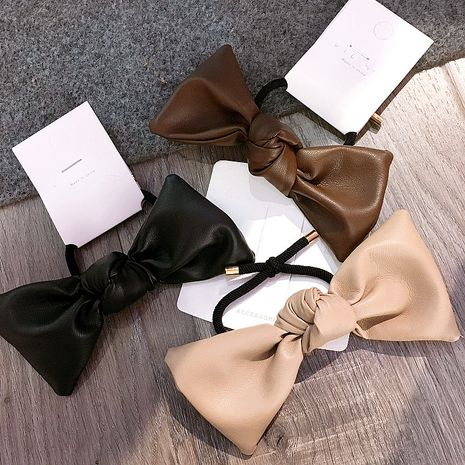 Korean  new simple leather bow tie all-match retro hair  ring  NHHI270721's discount tags