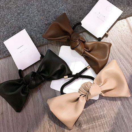 Nuevo anillo de pelo retro de todo fósforo con pajarita de cuero simple coreano NHHI270721's discount tags
