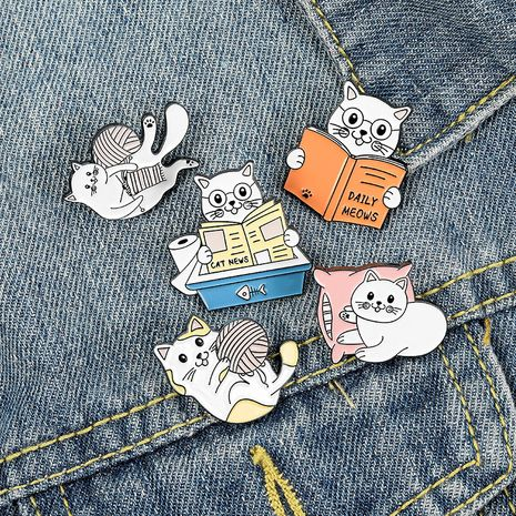 Cute cat reading book kitten thread ball cartoon corsage wholesale brooch NHBO271456's discount tags