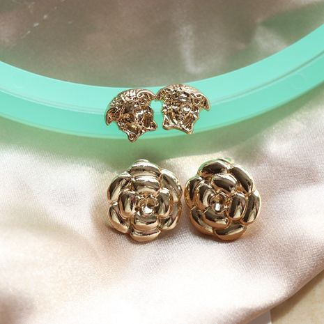 simple all-match  golden flower earrings NHOM271488's discount tags