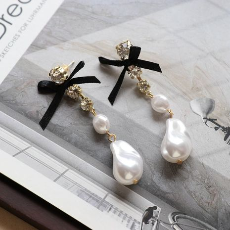 White Special-shaped Pearl Bow Long Stud Earrings  NHOM271489's discount tags