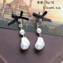 White Specialshaped Pearl Bow Long Stud Earrings  NHOM271489