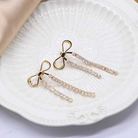 Golden bow tassel  claws diamond silver needle earrings NHOM271528's discount tags