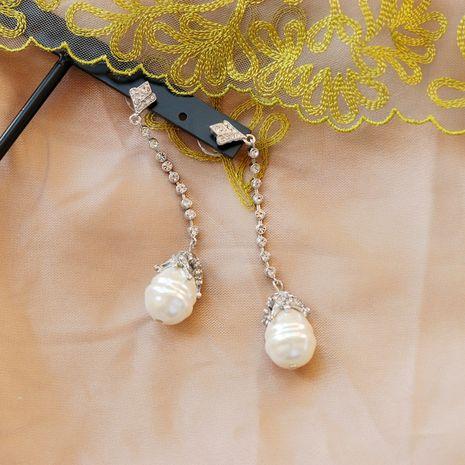 Large Pearl   Retro Shaped Pearl White Diamond Tassel Earrings NHOM271534's discount tags