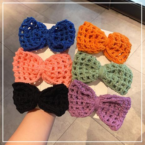 New hollow knitted big bow hairpin NHOF272239's discount tags